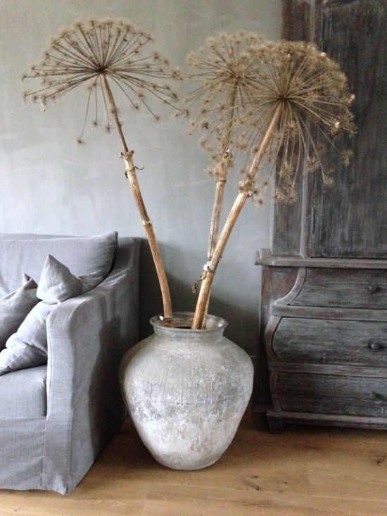 Dried allium heads in a rustic pot make a perfect and unusual flower arrangement! #CavetoCrib