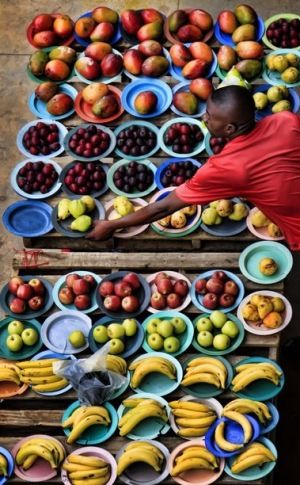 Soweto Market, Johannesburg. In South Africa fruits and vegetables are vastly grown and loved. There are markets in almost every town to serve the towns people. Most small towns don't have grocery stores