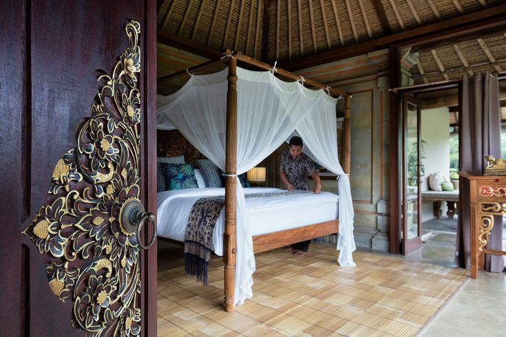 The spacious main bedroom upstairs with a king-size extra-length Balinese teak bed.