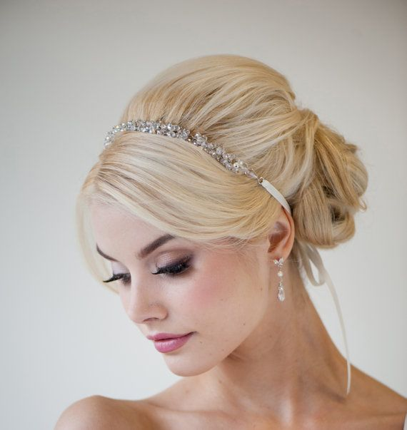 crystal hairband, fringe, beehive and a veil. like this a lot