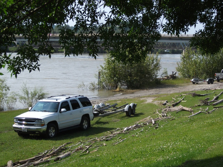 Fraser River in Quesnel. Note where the driftwood has accumulated in comparison to the SUV which is parked at s boat launch.