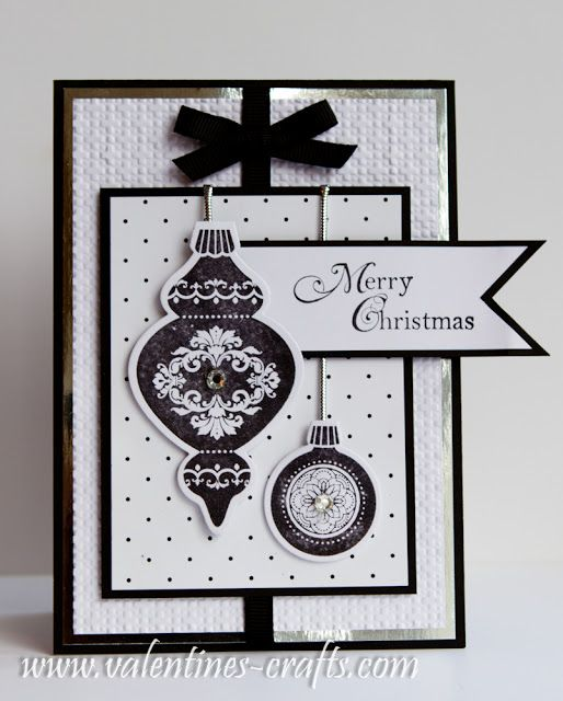 handmade Christmas card ... white and black ... sophisticated look ... black mats, bow and stamped ornaments ... like the layout design ... great card! ... Stampin' Up!