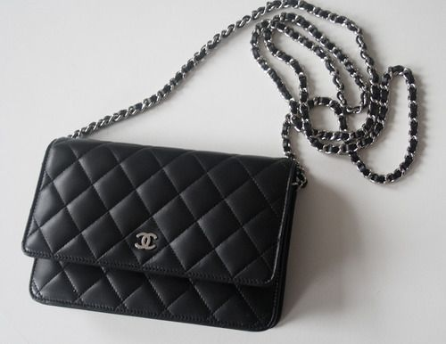 Bag for the night has to be a classic Chanel with shoulder chain.