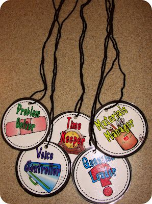 Each kid in the group has a job and wears one of these...on the front is a picture with their job name and on the back is the job...exs. problem solver/time keeper/voice controller etc.