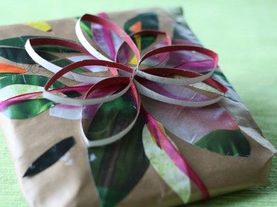 10 Stylish and Sustainable Ways to Wrap Gifts There's a natural tendency to want to wrap with brown paper bags; take a tip from wundoroo at Flickr who not only stamps the paper first, but them sews it together with a festive zig-zag!
