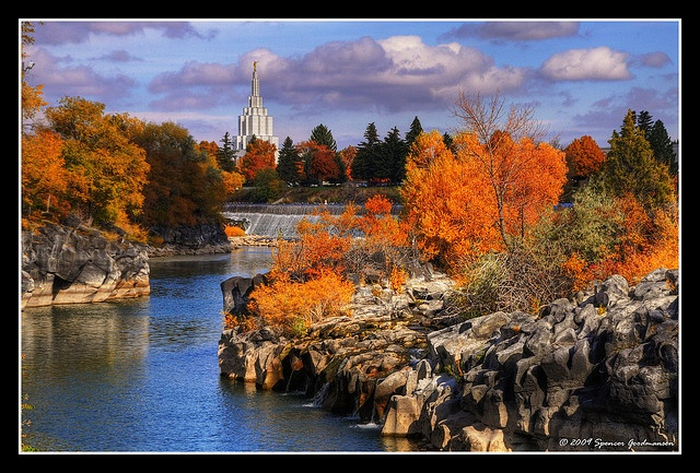 Idaho Falls Temple with falls and fall colors.