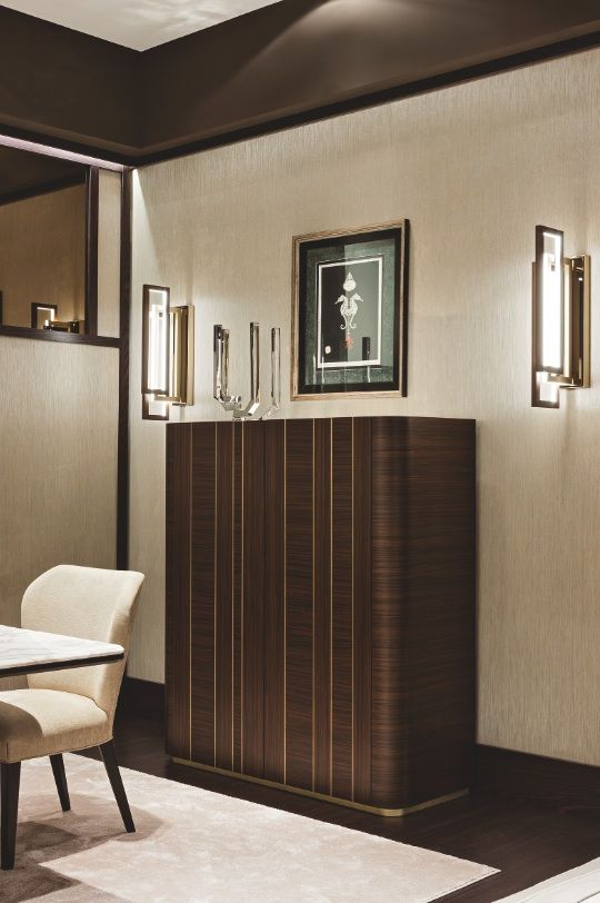 "The ""Symphony in Beige"" dining room by Oasis features a Godot cupboard, and two Edge wall lamps."