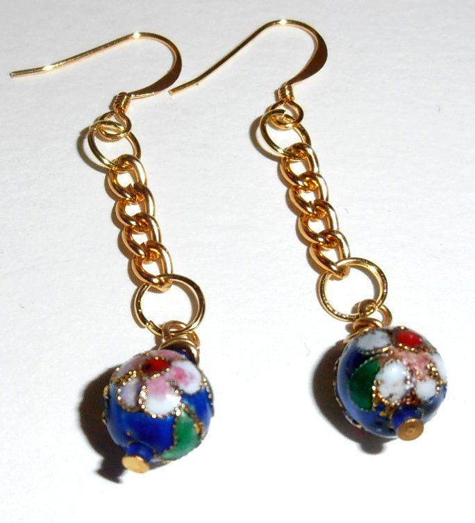 cloisonne beads with gold colored chain. They look very pretty dangling