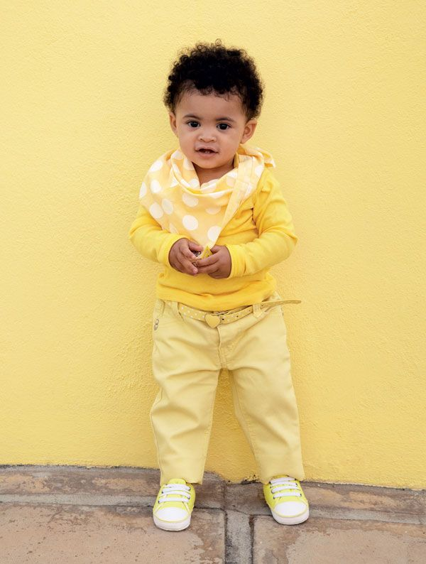 Emma (1) brightens things up in a yellow long-sleeved T-shirt and sneakers from Pick n Pay Clothing. Her jeans, with a polka-dot belt, are from Mr Price and the bandana is from Keedo.