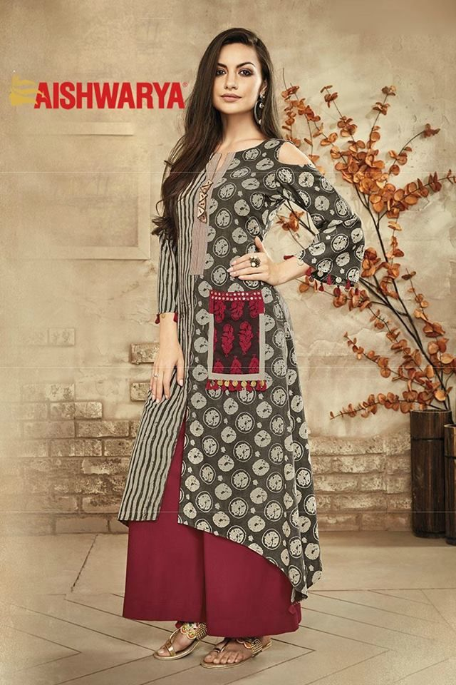 Get chic for a casual outing with this appealing designer suit. Buy Suit online - http://www.aishwaryadesignstudio.com/grey-and-red-printed-designer-suit