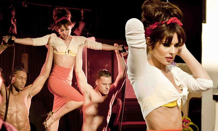 Neon bra, midriff-baring top and high-waisted skirt: Cheryl Cole adds the sexy to Suburbia in retro video shoot
