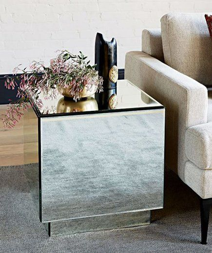 Geo Mirror Storage Side Table  One side of the mirrored accent table opens up to reveal a hidden drawer that's deep enough to hold blankets, small throw pillows, and stuffed animals. Use it as a nightstand or as a sofa side table.    $200 (originally $399)