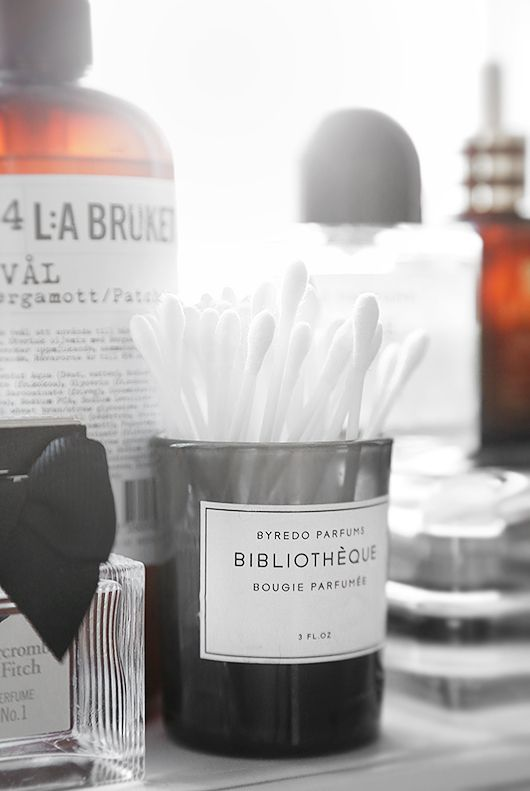 DIY bathroom storage made of scented candle holders from Byredo