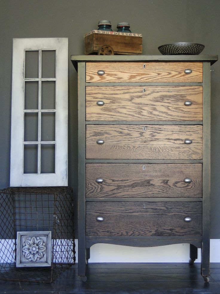 I love when I find this style oak chest because I know right away that I'll do a wood ombre piece. I like to mix it up with the case though. This one has a thin layer of black paint that is heavily distressed, so much that it almost looks like black stain with so much woodgrain showing through the paint. Modern Vintage