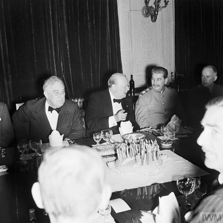 Winston Churchill with President Roosevelt and Stalin at a dinner party at the British Legation in Tehran during Churchill's 69th birthday, 30 November 1943