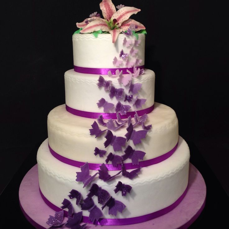 Wedding cake with Lilly flowers and butterflies