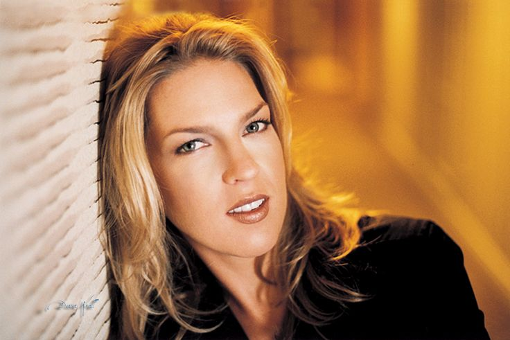 Diana Krall is very good at singing jazz standards in a smoky and sexy voice, accompanied by her own deft piano and often a swinging trio or a lush orchestration. Description from popmatters.com. I searched for this on bing.com/images