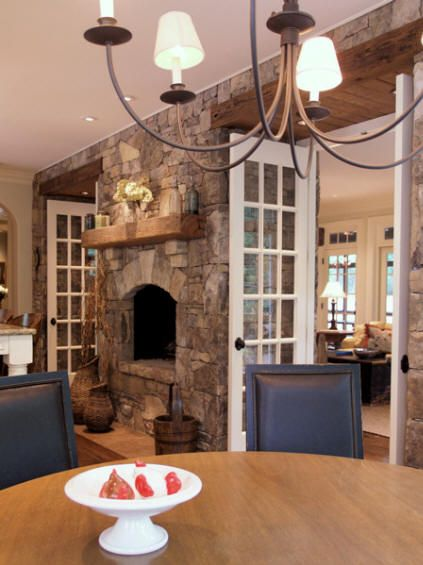Fireplace And French Doors Between Dining Room Living