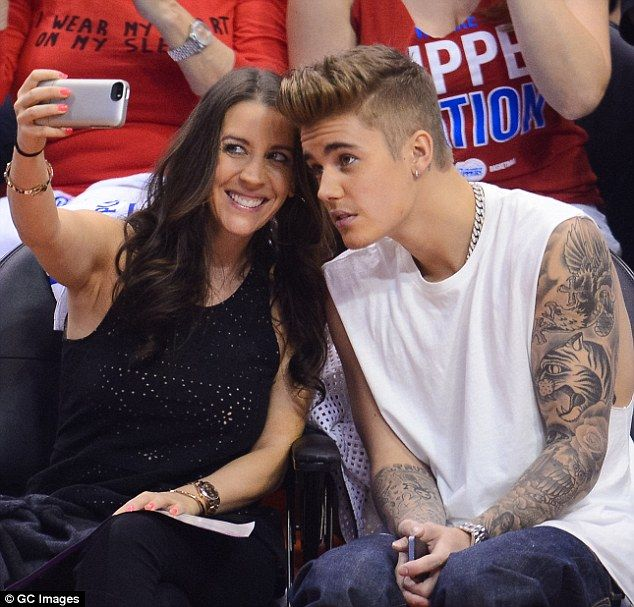 Smile! Justin Bieber poses for a Mother's Day selfie with mum Pattie Mallette during the Los Angeles Clippers game Sunday at the Staple Center