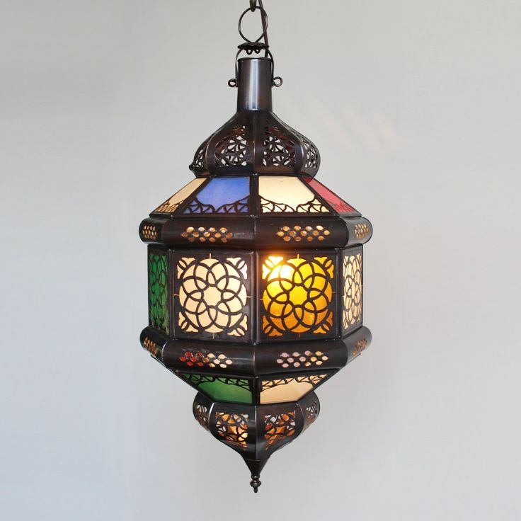 Check out our amazing lights at Mix Furniture!! Colorful red green blue and yellow glass with metal work lantern.