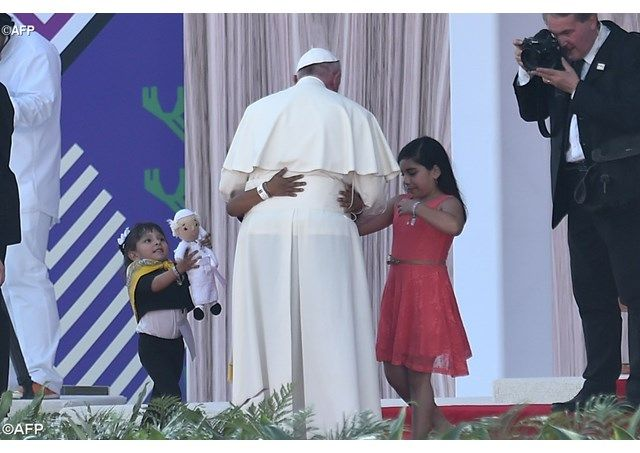 Pope Francis welcomed by children as he arrived at a meeting with Mexican Families at Tuxtla Gutierrez Stadium - AFP