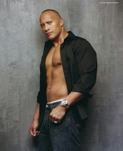 """Dwayne Johnson """"The Rock"""" I hate the whole wrestling scene but, I love the Rock... He's a funny, attractive guy, muscles without being too bulky."""