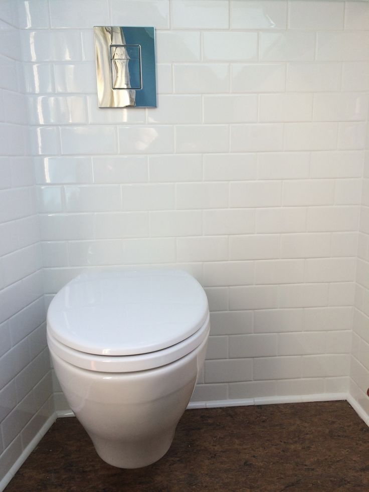 Wall Mounted Toto Toilet With A Grohe Concealed Water Tank