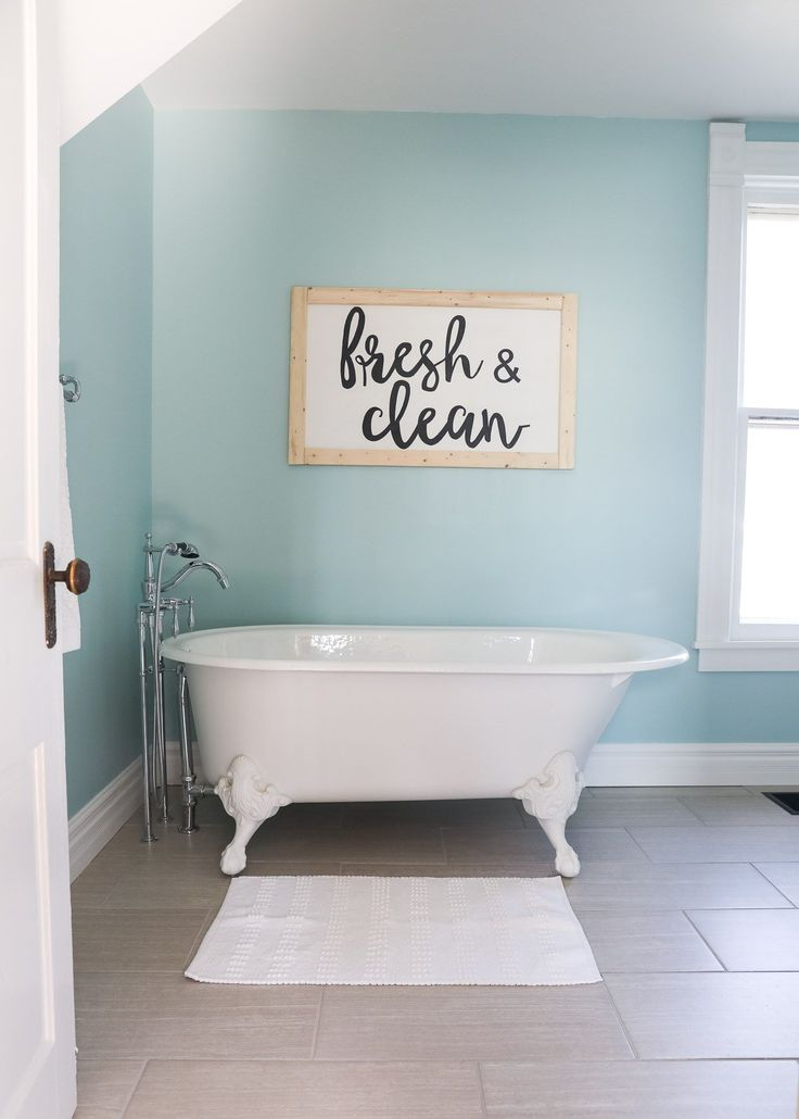Fixer Upper Bathroom Before and Afters... fixer upper style bathroom makeover with clawfoot tub, watery paint color and sliding bar door.