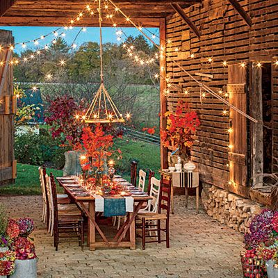 Love the ambiance of this outdoor room, the fall theme, lights... stunning!