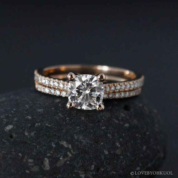 A simple yet endlessly endearing wedding set to bring you all the way from your spark of I will to your bonding union of I do and long beyond, this Forever One moissanite engagement ring pairs perfectly with the half-eternity wedding band. The four-prong set cushion-cut moissanite center stone is just as brilliant and durable as the surrounding round brilliant cut diamonds on the band, and promises to sparkle endlessly. Select your preferred setting from 14kt rose, white, or yellow gold, and…