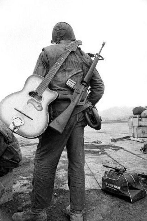 marine + guitar + m16 rifle - landing strip khe sanh -25 february 1968