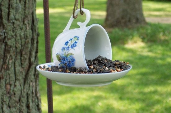 Tea Cup Bird feeder - use E6000 glue to glue the cup to the saucer, then let it sit overnight and hang it from a shepherd's hook