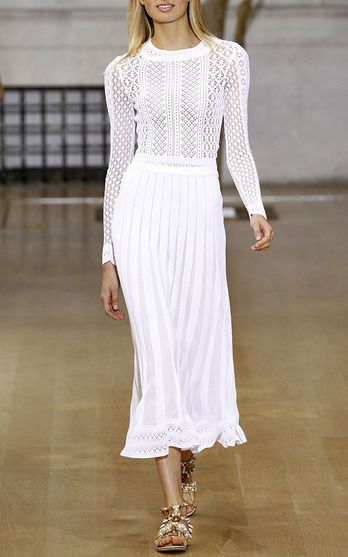 The Designers: The house (helmed by the de la Renta design team this season), is known for it's elegant approach to dressing—whether it be for day or evening. <br><br> This Season It's About: Something for everyone: ethereal white dresses for the romantic, printed crop tops (with matching skirts) for the bohemian and a feathered mini for the party girl. Pairing each with flat sandals sent the message to dress it down.