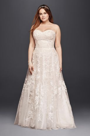 """Soft panels of floral and scalloped lace fall gracefully from the appliqued bodice of this sweetheart A-line extra length wedding dress. Hand beading and a blush underlayer give the look a warm glow.   Melissa Sweet, exclusively at David's Bridal  Plus size, 4"""" extra length  Polyester  Sweep train  Back zipper; fully lined  Dry clean  Imported  Also available in Regular Plus Size"""