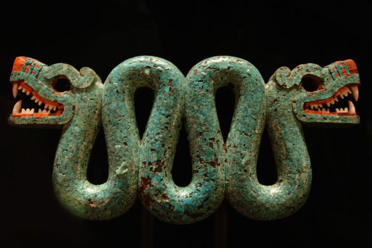 Two-headed turquoise serpent which was probably used as a chest ornament during ceremonial occasions. It is made of carved wood covered with turquioise, with red and white shell being used for the mouth and eyes. It was likely created in Mixtec areas under Aztec control between 1400 and 1521.