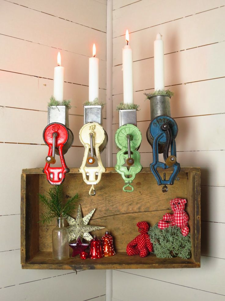 Nut grinders as candle holders on old wood box turned holiday shelf display