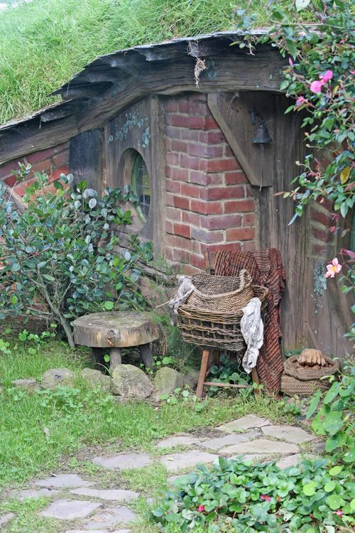I would love to have a secret little hobbit house hidden away in the bushes.