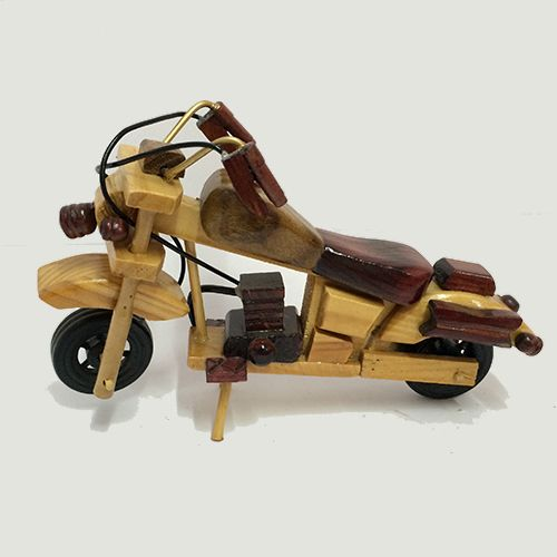 Oyeart unique miniature wooden bullet bike. This bullet bike showpiece can be used as a toy by kids or to just give a vintage distinct look to your home living area. Bullet bike is one of the most famous bike on Indian roads.