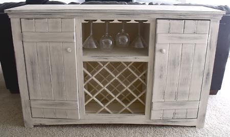 not crazy about the whitewash finish, but love the concept of the wine rack and glass holder console.