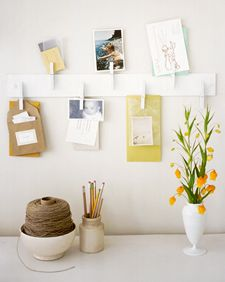 I could easily make a clothespin hanger like this. Think this would be great for cards, invitations & short-term activity information papers the kids bring home. Especially if I designate them their own clothespins on it............ideas, ideas!