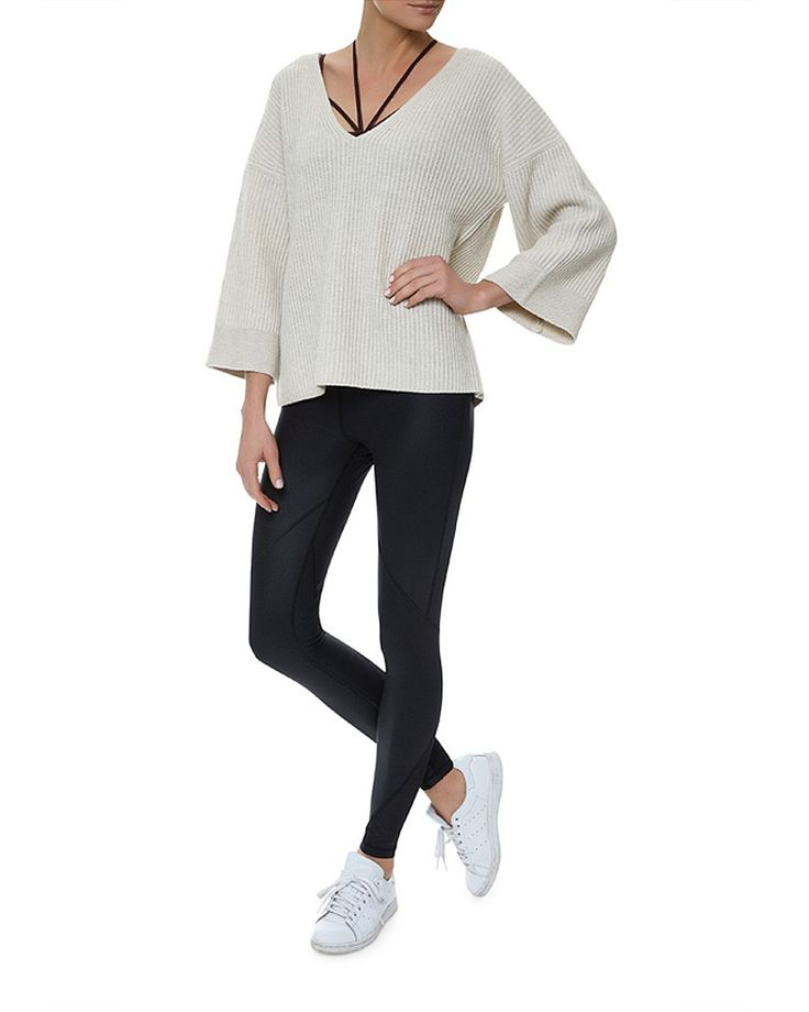Nail nomadic style in this oversized jumper with contrasting ribbed panels. Constructed in a premium cashmere-blend knit with a deep V neck and bracelet sleeves, layer over a merino high neck knit and wet look leggings for a cool London aesthetic.
