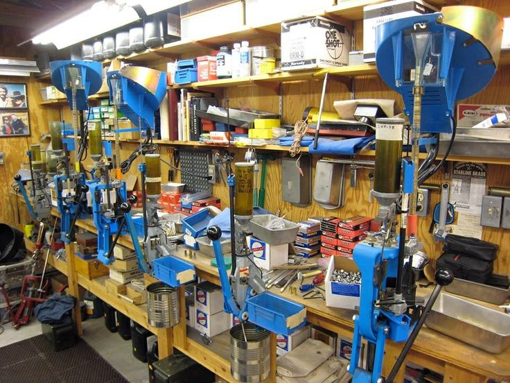 """Bob Munden's reloading station. """"Bob didn't like slowing down when working in the shop to convert a press set up for each caliber. He had a press set up for each caliber that he used most often, and so he could load for sighting in customers guns. The presses I use are set up for .45 colt, .357/.38 sp, 44-40, .44 sp, and .45 ACP."""" - Jeff Ault"""