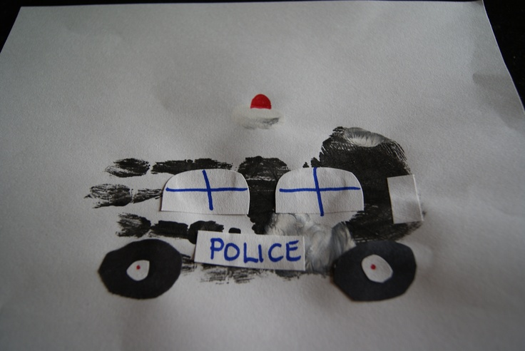 Police car hand print art.  The preschoolers love to have their hands painted.  Just add some wheels, window's and a headlight and police sign. We had lots of fun making these at Scribbles Preschool during our Police themed week.