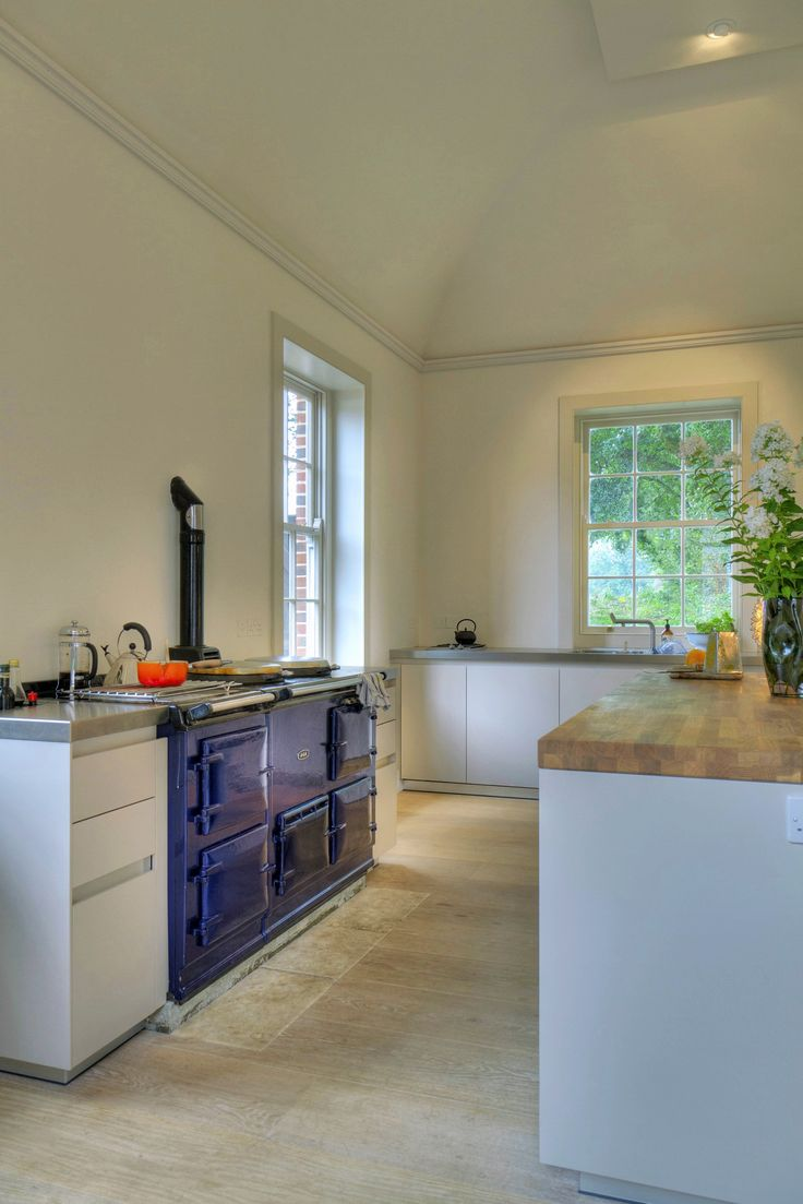 bulthaup b1 in Greige abuts with the blue AGA. All the nostalgic comforts of an AGA but within the modern sleek design of bulthaup. Kitchen by bulthaup Winchester.