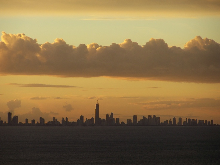 Sunset over Surfers Paradise with the silhouette of #Soul