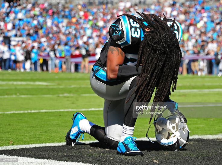 Tre Boston #33 of the Carolina Panthers kneels in the end zone to pray before the game against the Seattle Seahawks on October 26, 2014 at Bank of America Stadium in Charlotte, North Carolina.