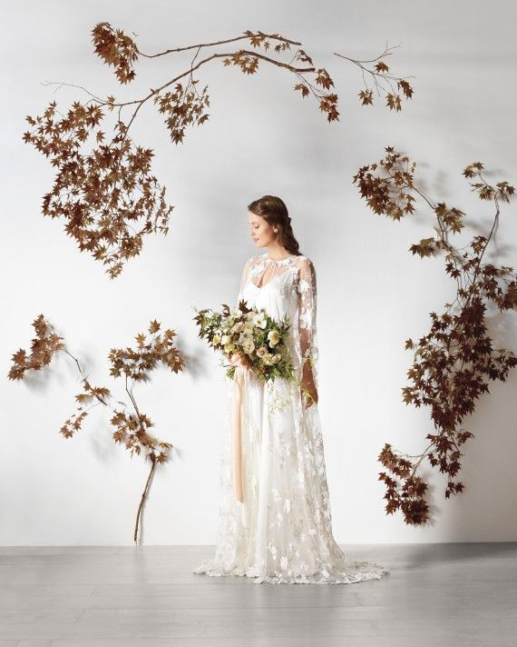 """Fall flowers can sometimes look heavy, but this ceremony marker made of Japanese maple branches is airy—it's as much about the negative space as the space that's filled,"" says Sarah Winward, owner of Salt Lake City floral design shop, Honey of a Thousand Flowers. It's also surprisingly inexpensive and easy to create: some branches hang from monofilament, while others are simply secured to the wall with white gaffer's tape."