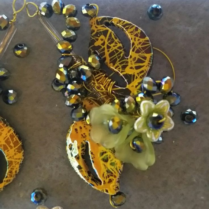 $ 27 . My latest earring design, beautiful drawbench beads and crystals all wire wrapped with sprays of dainty flowers.