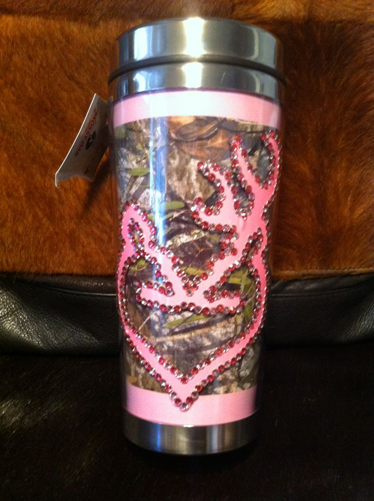 $18 Travel Tumbler 16 oz - Mossy Oak Camo background trimmed in pink . Design is of a pink Double Deer Heart trimmed with purple and pink bling. Each individual rhinestone is hand placed., Stainless Steel Interior, Push seal lid for sip & sip closure. Safe for hot and Cold Beverages.  Available on Etsy store SassySouthernCharm1