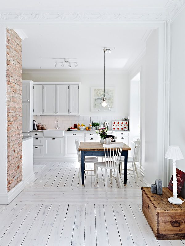 Lovely home in Gothenburg Sweden. Love this but don't think I could/would actually do the white floors.